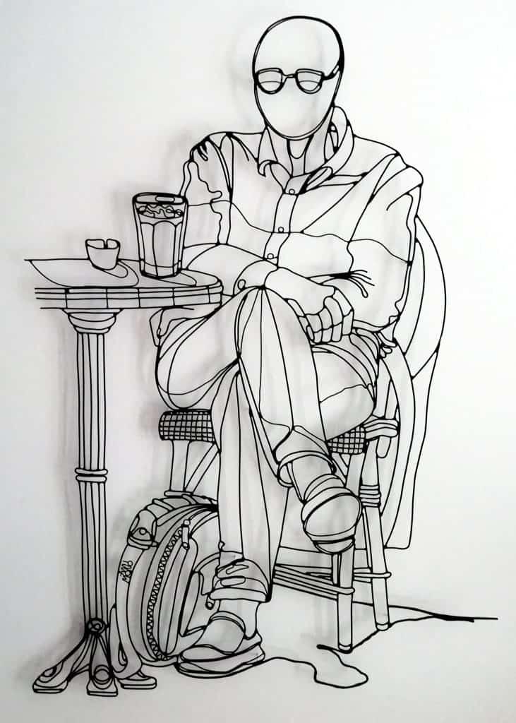 Un homme, une bière et son regard